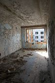 Постер, плакат: Interior Of A Ruined Dwelling House Of Soviet Soldiers And Their Families In The Former Military Are