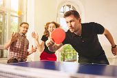 Group Of Happy Young Friends Playing Ping Pong Table Tennis At Office Or Any Room. Concept Of Health poster