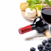 stock photo of red wine  - Red wine with French cheese selection over white - JPG