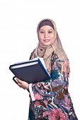 Beautiful liberated Muslim woman with books.