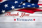 American Flag On A White Worn Wooden Background With Veterans Day Greeting poster