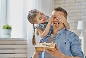 Happy fathers day! Child daughter congratulating dad and giving him gift box. Daddy and girl smilin poster