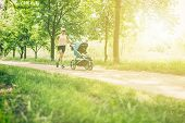 Running Woman With Baby Stroller Enjoying Summer Day In Park. Jogging Or Power Walking Supermom, Act poster