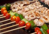 barbecue grill with tomato and green paprica