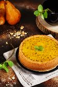 Cheese Cake With Passion Fruit On A Dark Background. Cheese Cake With Passion Fruit Sauce On Top, De poster