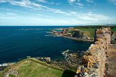 View Of The Sea Bay With Rock Coast And The Wall Of A Old Castle. Oxroad Bay, East Lothian, Scotland poster