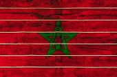 National Flag  Of Morocco On A Wooden Wall Background. The Concept Of National Pride And A Symbol Of poster