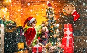 Cute Boy Play Near Christmas Tree. Kid Enjoy Winter Holiday At Home. Home Filled With Joy And Love.  poster