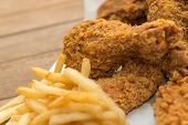 Fried Chicken And French Fries Or Chips (potato) poster
