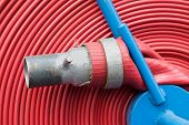 foto of hookup  - Red Firemen Hosepipe rolled with blue details in hi resolution - JPG