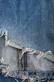 torn old blue jeans background