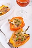 peppers stuffed with cheese and mushrooms with glass of wine