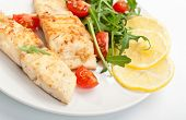 white fish with vegetables and lemon