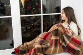 Comfortable And Warm. Little Child Feel Comfortable At Xmas Home. Small Girl Relax On Window Sill. C poster