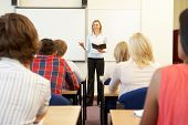 stock photo of tutor  - Students and tutor in class - JPG