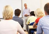 stock photo of senior class  - Senior tutor teaching class - JPG