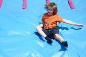 stock photo of childrenwear  - Child playing on a slide - JPG