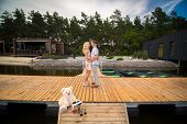 Loving Young Couple Kisses On A Wooden Pier. Lovestory On The Pier. poster
