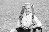Homeschooling. Vintage Kid Fashion. Schoolgirl In Retro Uniform Read Book. Small Happy Girl Study Li poster