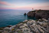 View Of The Lighthouse And Cliffs At Cape St. Vincent At Sunset. Continental Europes Most South-west poster