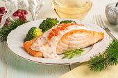 Baked Salmon Fillet With Broccoli And Creamy Sauce. Main Course For Lunch Or Dinner With Christmas D poster