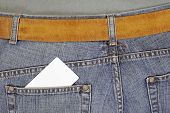 Closeup of credit card in back jeans pocket