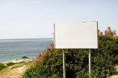 Blank Advertising Billboard Display And Table, Sea In Background. Advertising Agencies. Billboard Wi poster