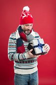 Winter Trends. Knitted Hat Scarf Sweater. Winter Knitwear. Mature Man Red Background. Buy Gift. Bear poster