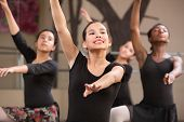 stock photo of leotards  - Group of four young Black and Latina dance students - JPG