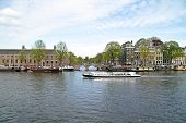 Cruising on the river Amstel in Amsterdam the Netherlands