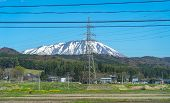 Snow Capped Mount Iwate With Clear Blue Sky Natural Background, Beauty Townscape Of Takizawa And Shi poster