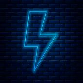 Glowing Neon Line Lightning Bolt Icon Isolated On Brick Wall Background. Flash Sign. Charge Flash Ic poster