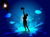 Silhouette of a basketball player at court with basket ball trying to goal on grungy rays background