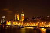 Landscape of Big Ben along river Thames from Hungerford Bridge at night London England UK