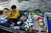 Vietnamese woman selling goods in the Cai Rang floating market, Mekong Delta, Vietnam