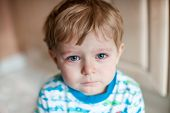 stock photo of crying boy  - Crying toddler boy with blue eyes and blond hair - JPG