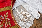 Antique set of a white lace priest surplice and 19th century damask chasuble