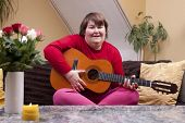 Mentally Disabled Woman Playing Guitar
