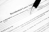 picture of rental agreement  - Lease agreement with pen. Used selective focus and shallow Depth of field.