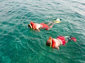 Two Men In The Life Vests Snorkeling