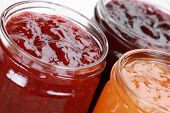 foto of apricot  - Marmalade jars with jam made from strawberries cherries and apricots - JPG