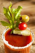 pic of bloody  - Spicy Bloody Mary Alcoholic Drink with a tomato garnish - JPG