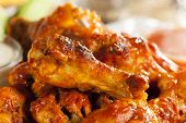 stock photo of red meat  - Hot and Spicey Buffalo Chicken Wings with celery - JPG