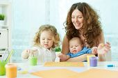 foto of finger-painting  - Happy mother and kids doing finger - JPG