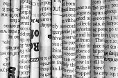 foto of current affairs  - A black and white photograph of English Language newspapers folded and stacked in a row to provide a background - JPG