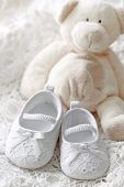 image of christening  - Baby girl shoes and teddy bear on white background - JPG