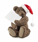 Teddy bear with blank note isolated on white background