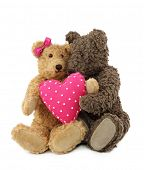 Two teddy bears with pink heart isolated on white background