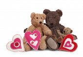 Family of teddy bears with hearts