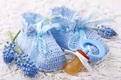 Handmade blue baby booties with dummy and flowers
